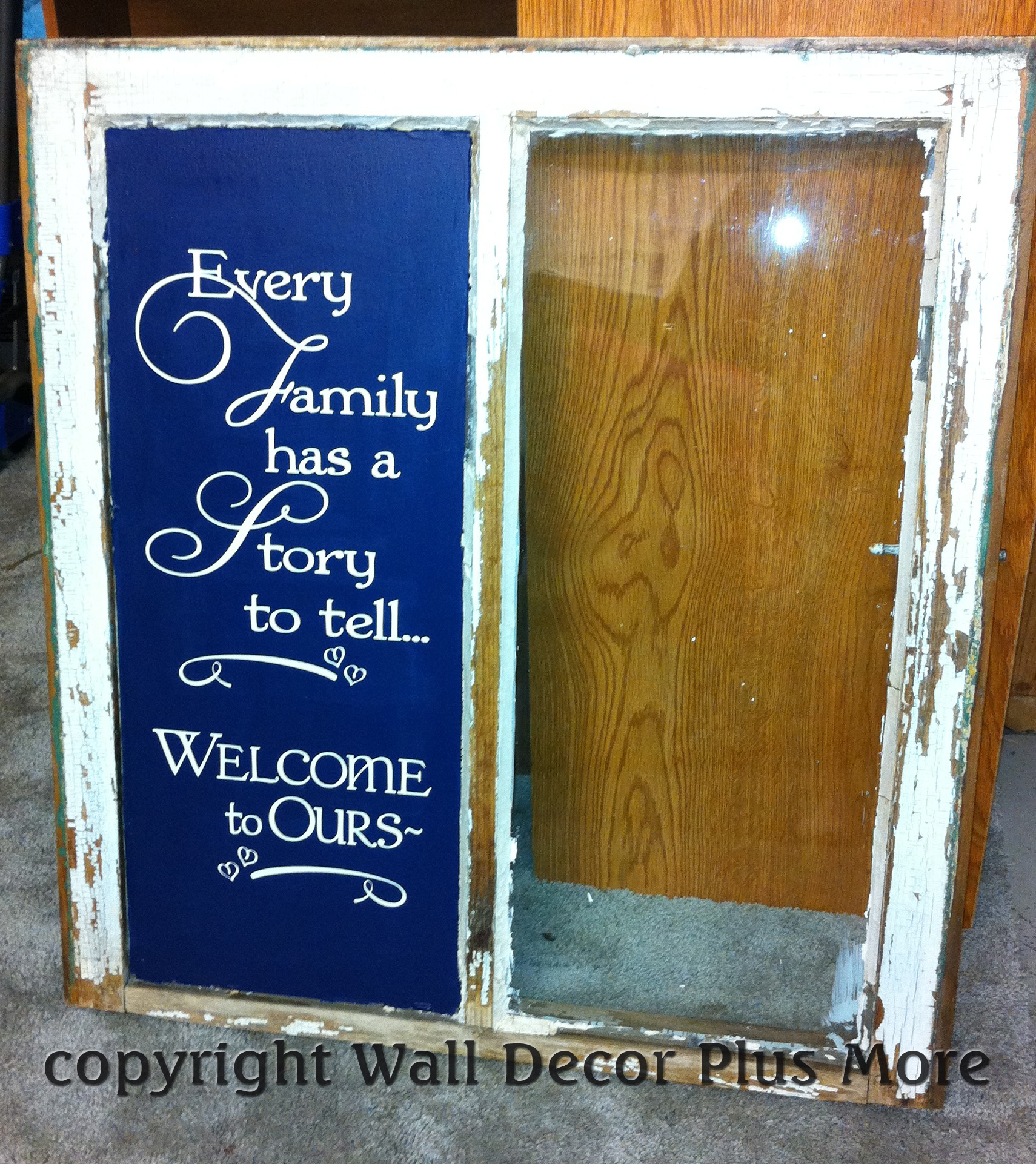 Family Has a Story Welcome Decal on old window glass